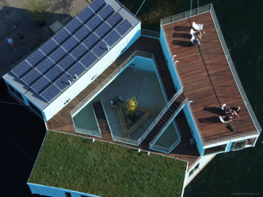 An aerial view of the Urban Rigger reveals sustainability elements, communal green space and the internal courtyard.